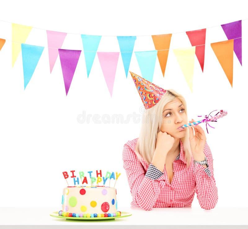 Sad birthday girl with a cake royalty free stock photo