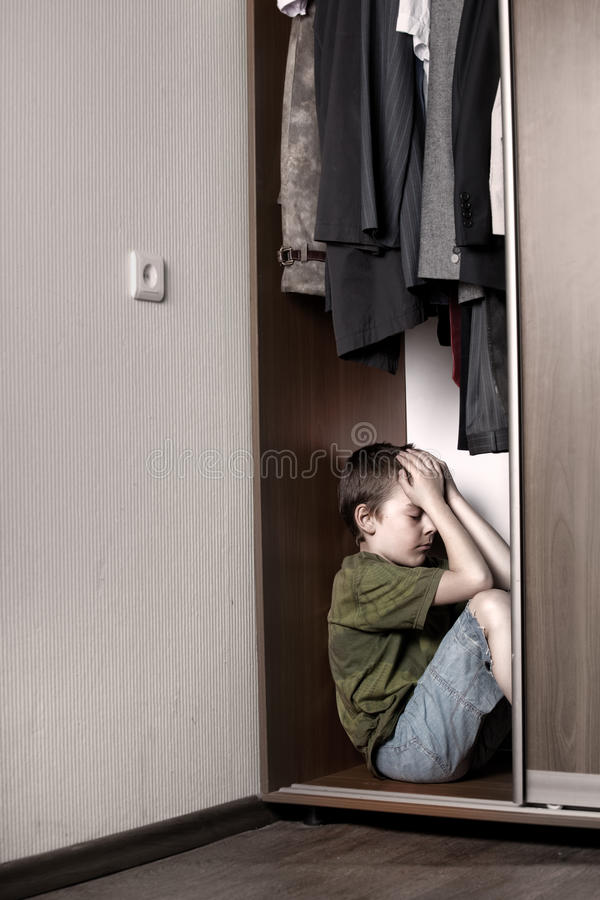 Download Sad Boy, Hiding In The Closet Stock Image - Image: 18917491