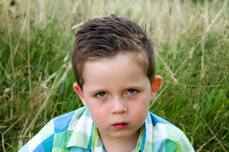 Download Sad Boy Scowling Whilst Looking Ahead Stock Image - Image: 26297547