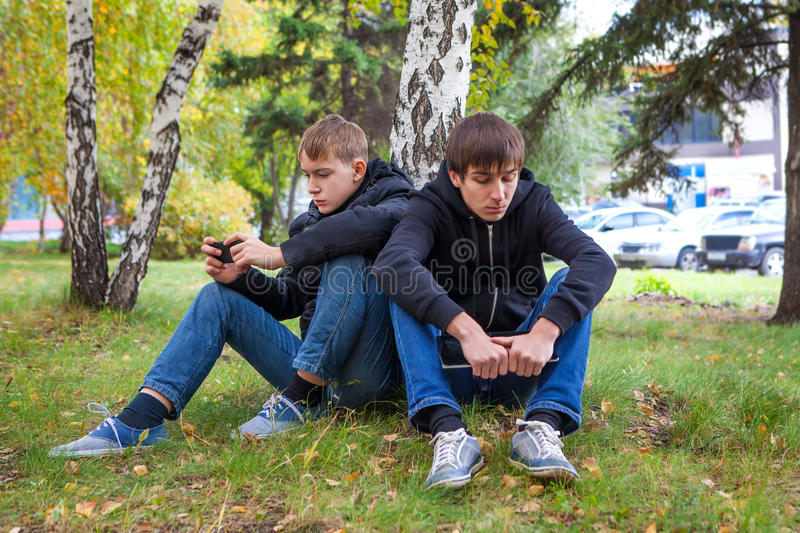 Sad Boys outdoor royalty free stock images