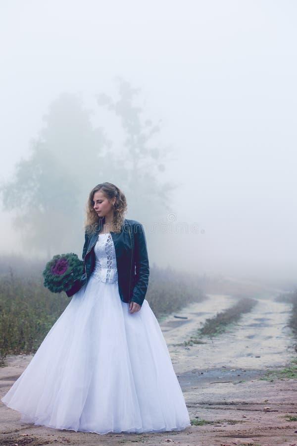 Sad bride near a road stock images