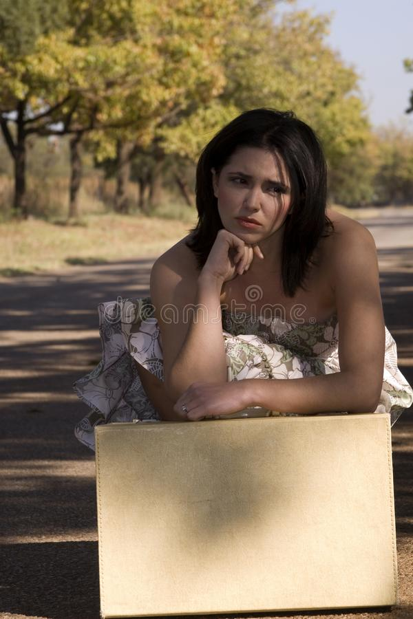 Download Sad brunette with suitcase stock photo. Image of alone - 2327160