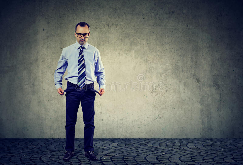 Sad business man with empty pockets royalty free stock photos