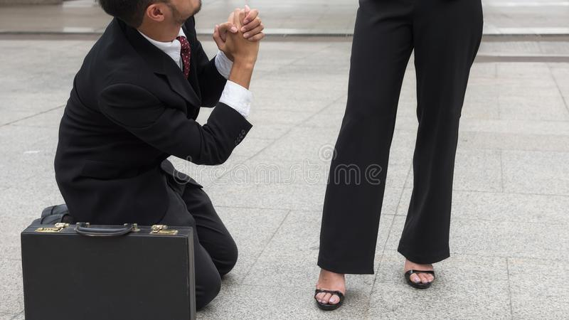 Businessman ask female boss for sympathy stock photo
