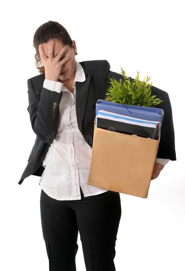 Sad Business Woman carrying Cardboard Box fired from Job stock photography