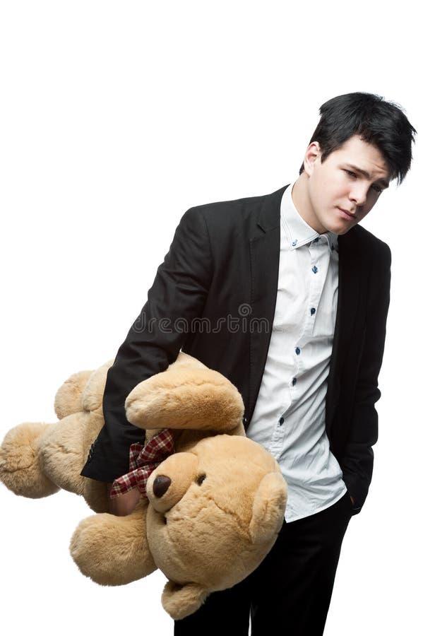 Download Sad Businessman Holding Big Soft Toy Stock Image - Image: 27644241
