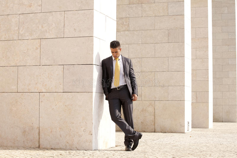 Sad Businessman Relaxing Next To Some Wall Stock Photography