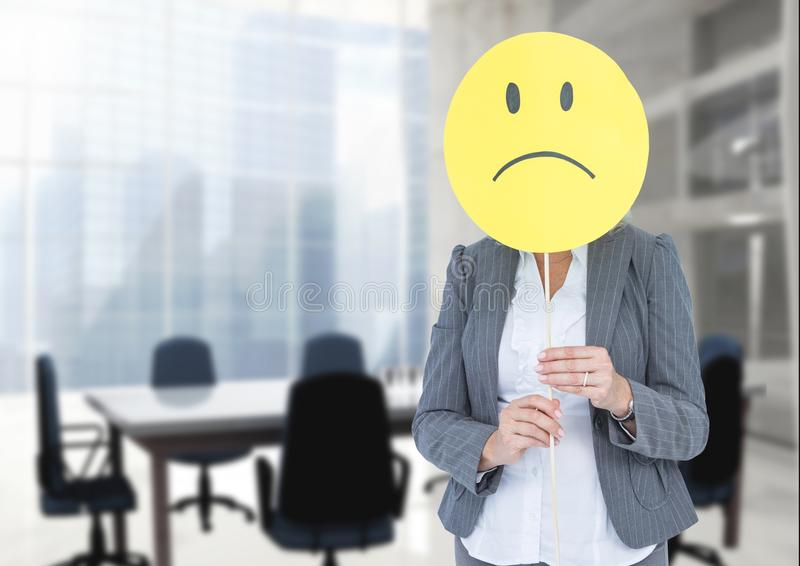 Sad businesswoman against office meeting room royalty free stock images