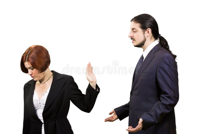Sad Businesswoman Refuse to Listen Businessman. Business Misunderstanding Concept - Blond Sad Businesswoman Refuse to Listen her Businessman Partner, Isolated on royalty free stock photography