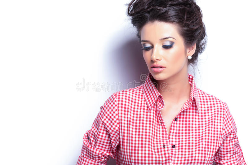 Sad casual woman looking down stock images