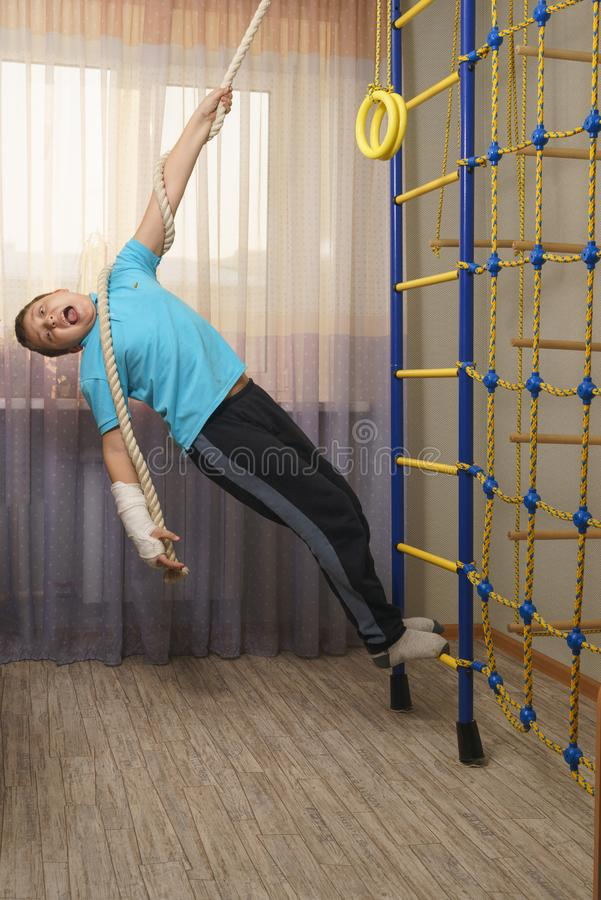 Sad child with a broken arm in the home environment . The cast on the hand of a little boy royalty free stock photo