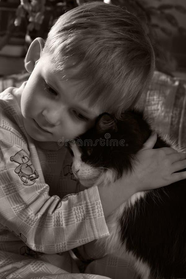 Sad child with cat stock image