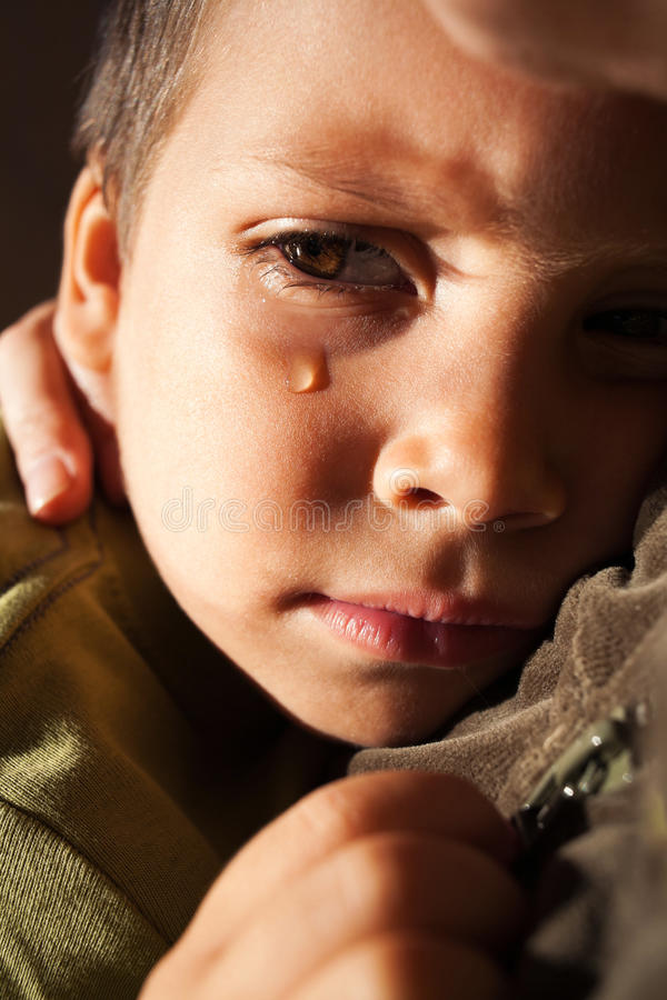 Sad child crying stock images