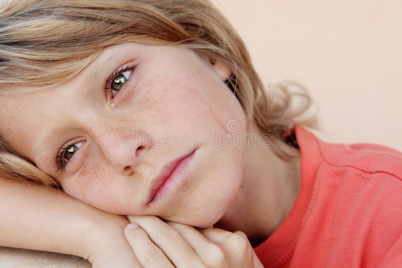 Sad child crying tears stock photo