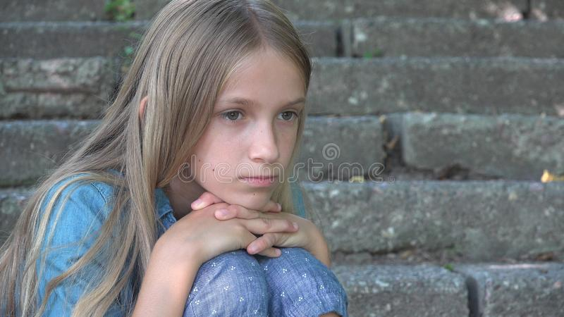 Sad Child, Not Playing Alone Kid, Unhappy Thoughtful Girl in Outdoor in Park stock image
