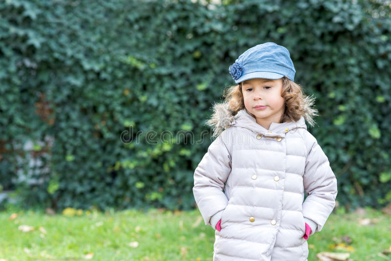 Sad child outdoor. Portrait of little sad child outdoor,selective focus royalty free stock images