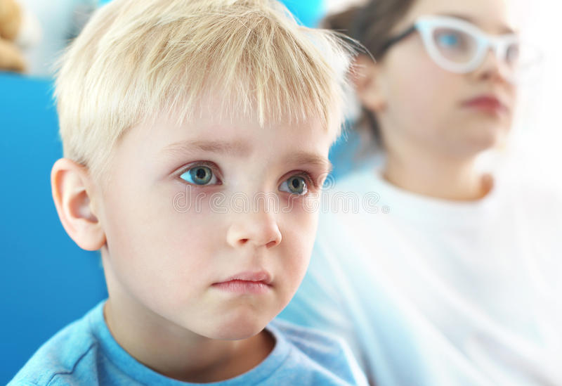 Sad child. Siblings, a boy and girl watching television stock photo