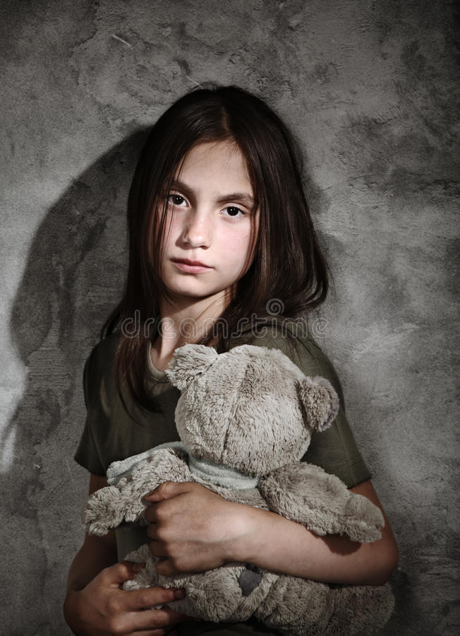 Sad child with toy stock photography