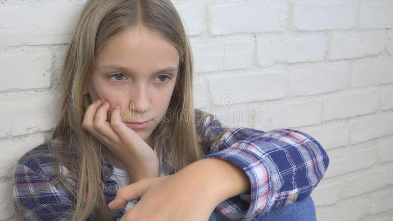Sad Child, Unhappy Kid, Sick Ill Girl in Depression, Stressed Thoughtful Person stock photo