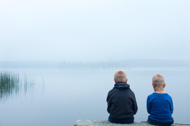 Sad children in a foggy day stock photo