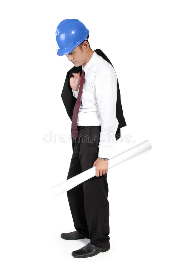 Sad construction worker. Young Asian construction worker expressing sadness of failure, full body shot, isolated on white background royalty free stock photo