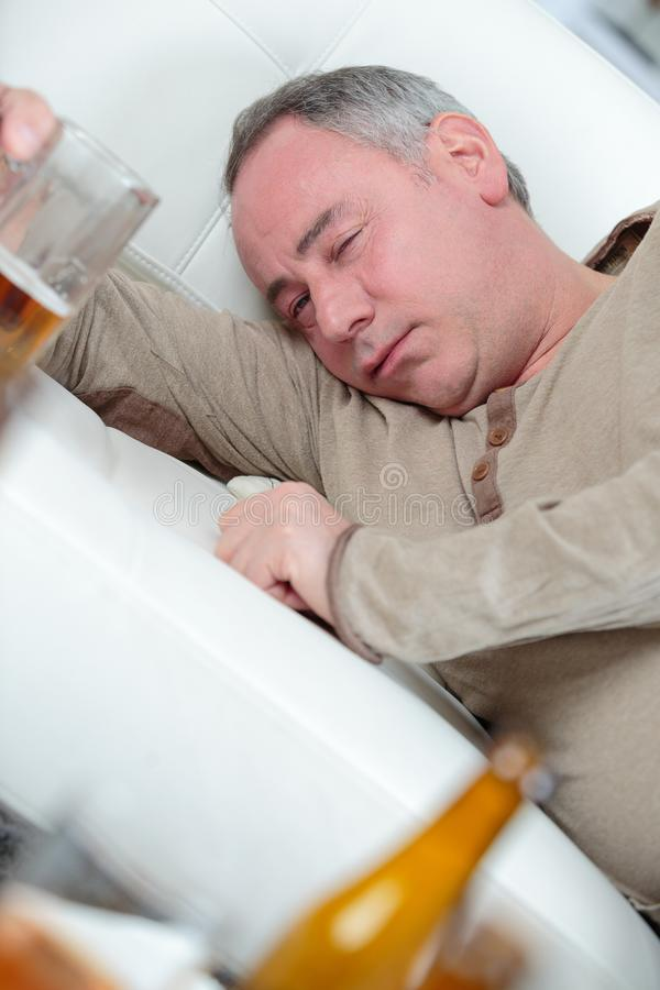 Sad depressed alcoholic businessman stock image
