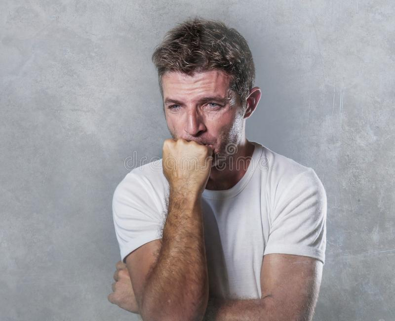 Sad and depressed man biting his fist desperate feeling frustrated and helpless in depression and sadness facial expression concep royalty free stock photo