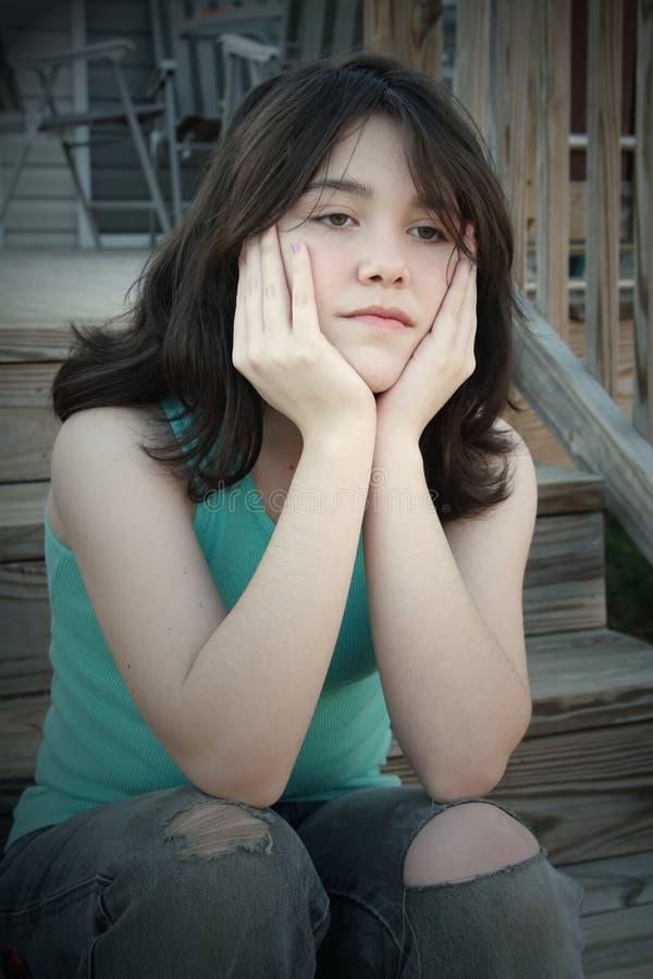 Sad Depressed Teen Girl On Stairs Royalty Free Stock Photos