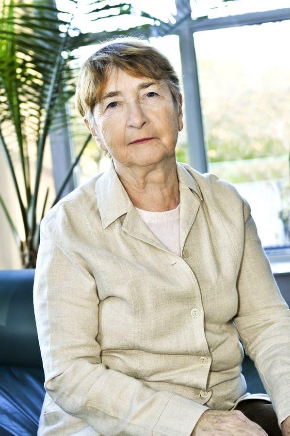 Sad elderly woman royalty free stock image