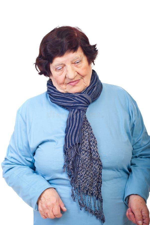 Sad elderly woman looking down stock photos