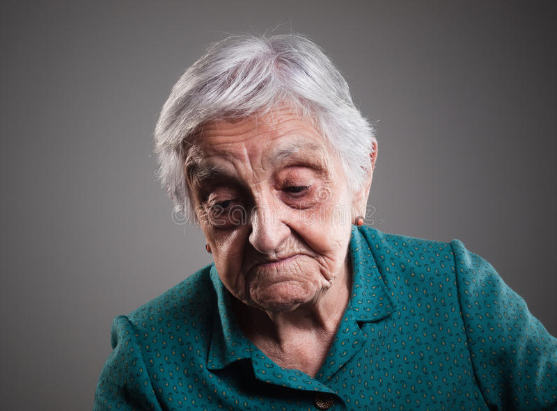 Sad elderly woman stock photography