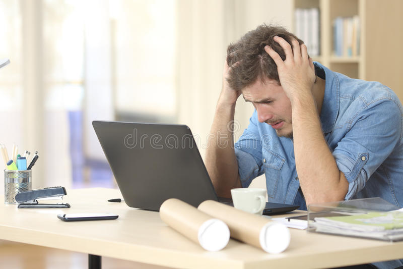 Sad entrepreneur worried about bad news royalty free stock photo