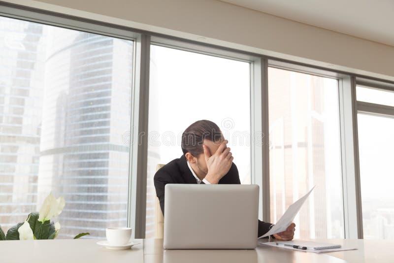 Sad entrepreneur worried bad statistics in report stock photos
