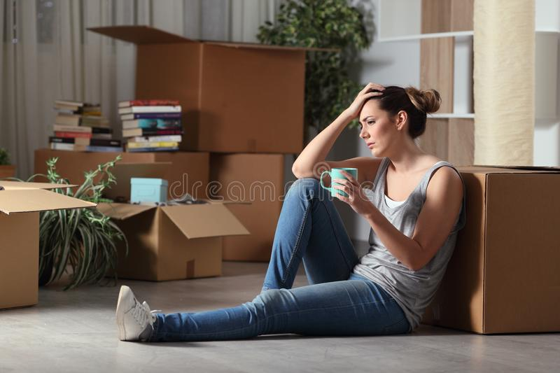 Sad evicted tenant moving home complaining on the floor royalty free stock image