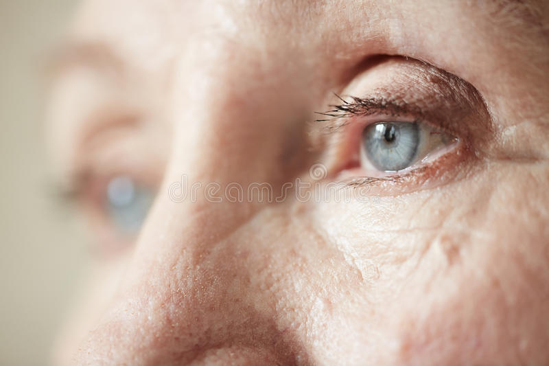 Sad eyes of elderly woman royalty free stock photo