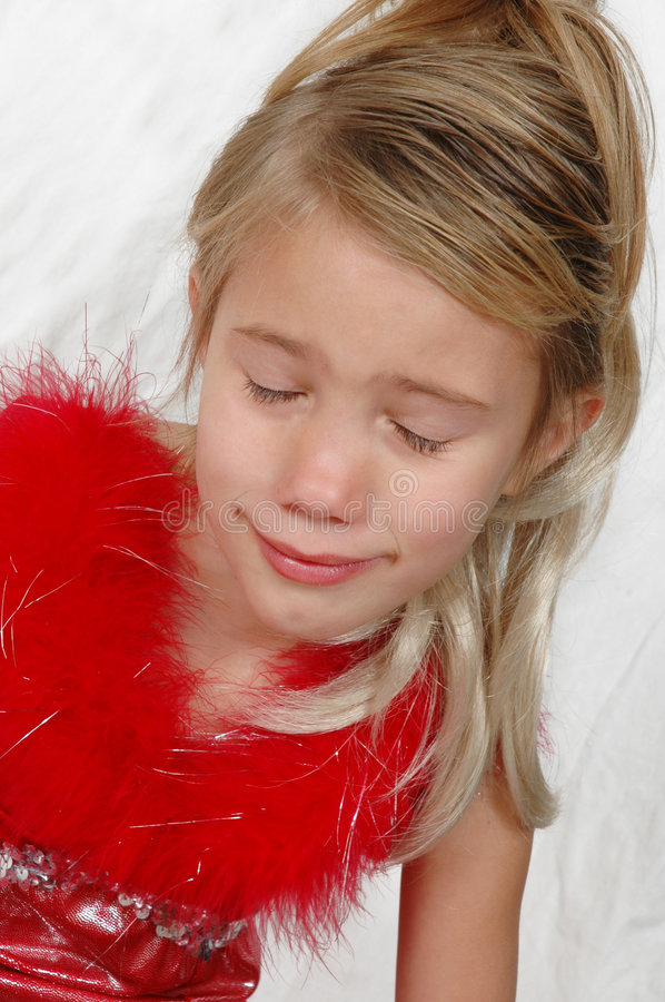Sad Face. Little girl in red outfit with long hair and her eyes closed. Expressions. Facial features. sad little girl stock images