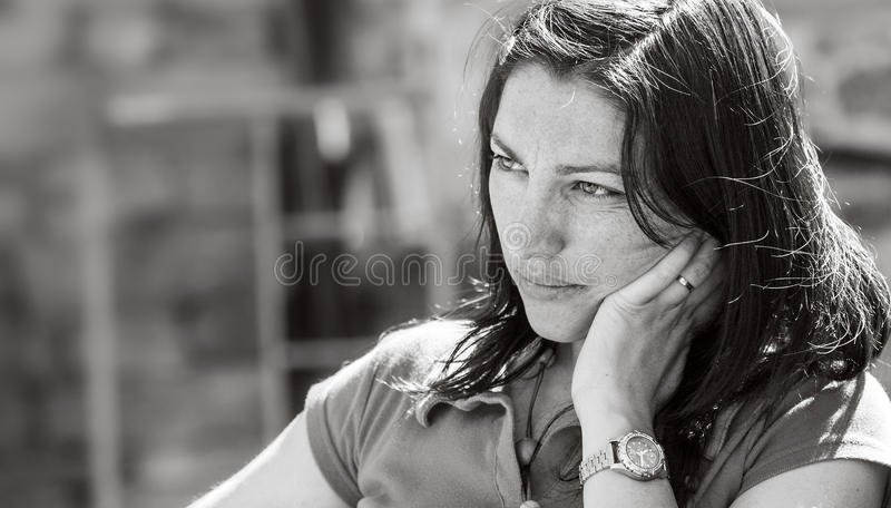 Sad face of a beautiful girl, black and white portrait. stock photography