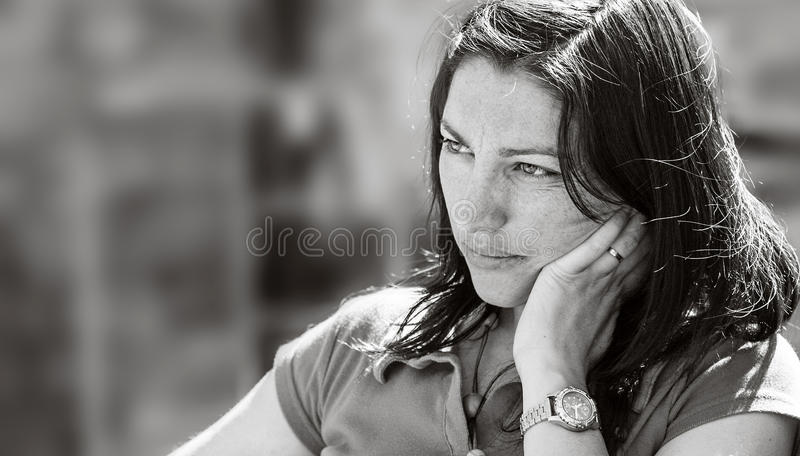 Sad face of a beautiful girl, black and white portrait stock photo