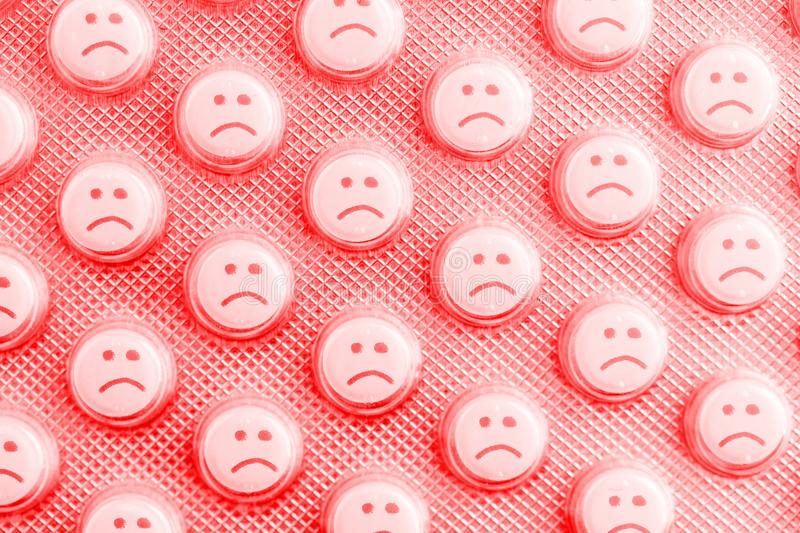 Sad face of pills. Negative side effects of drugs stock photo