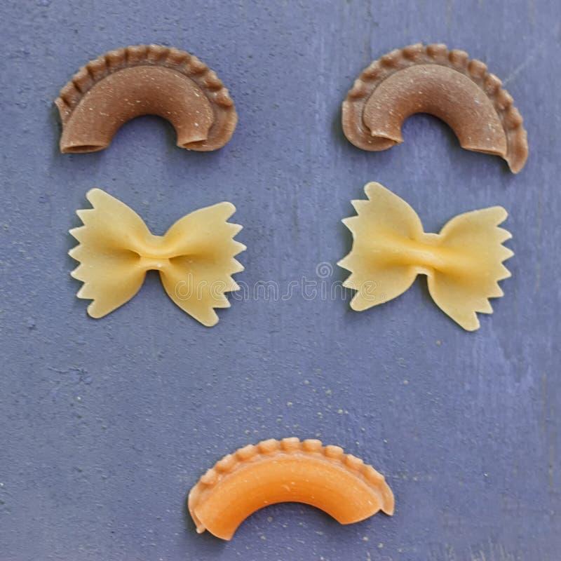 Sad face with raw pasta royalty free stock photo