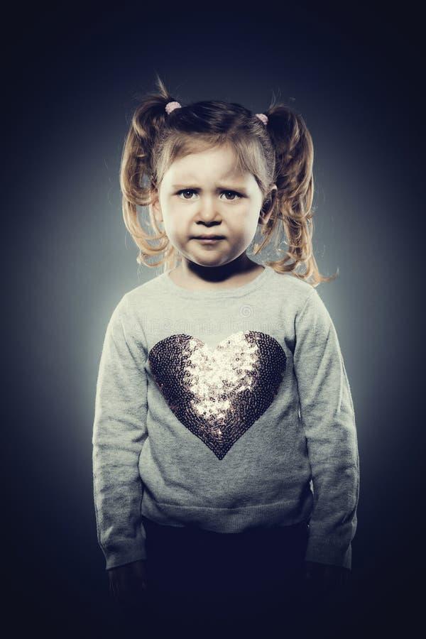 Sad female child stock photo