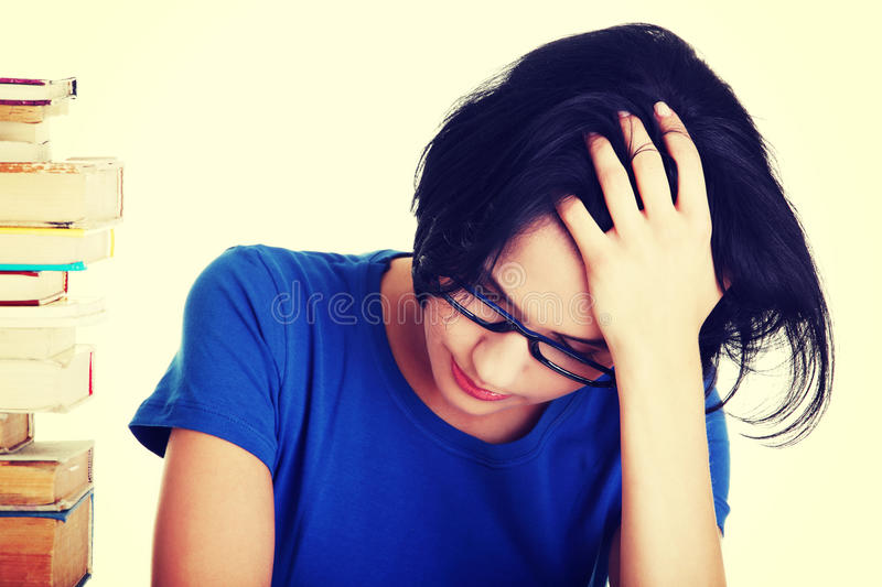 Sad female student with learning difficulties.  stock images