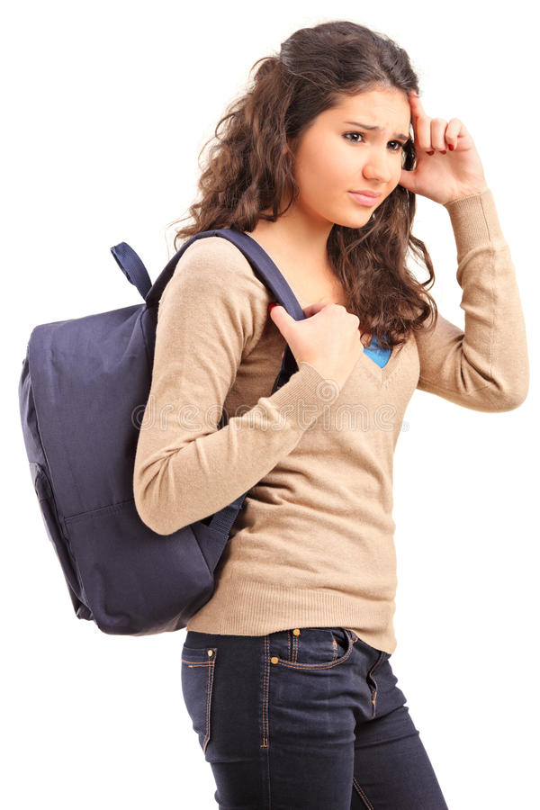 Sad female teenager with bag on her back posing royalty free stock photos