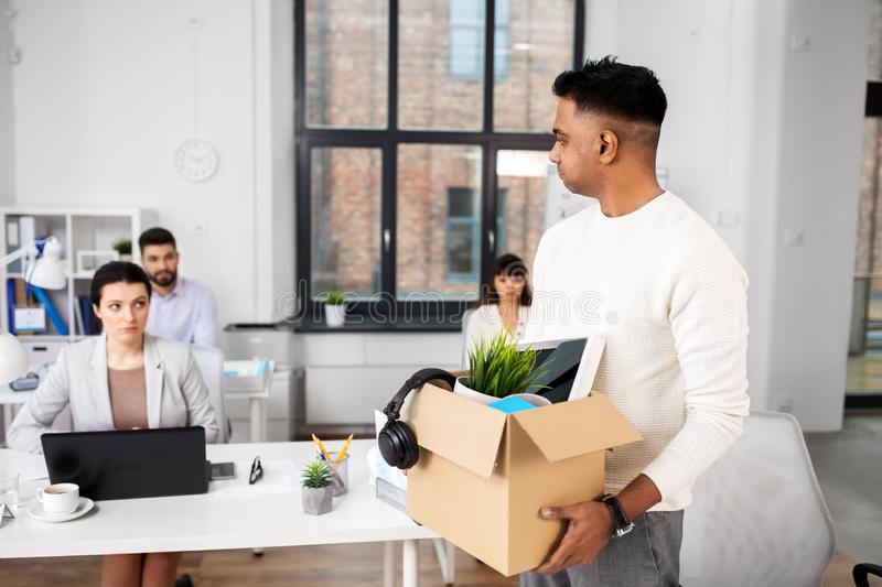 Sad fired male office worker with personal stuff royalty free stock images