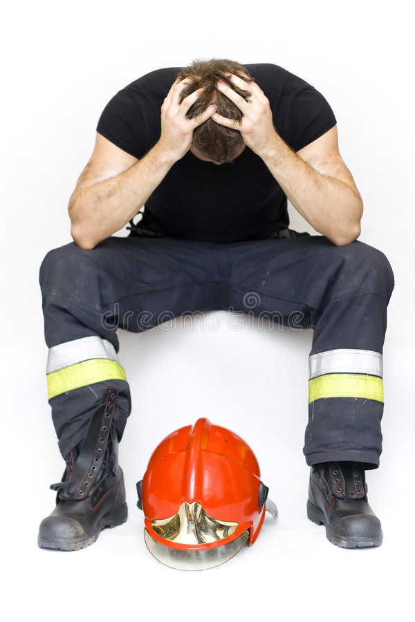 Sad fireman. After the action royalty free stock photo