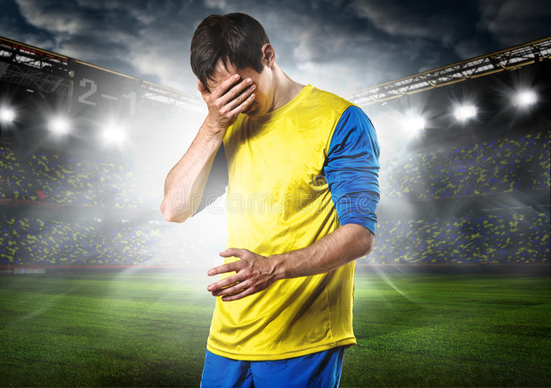 SAD fotboll för spelare royaltyfria foton