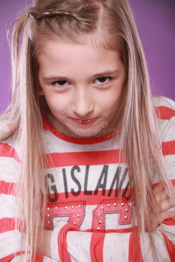 Sad funny girl showing her emotions blond kid thinking. Girl show her emotions alone with her face funny sad and happy currios royalty free stock photos
