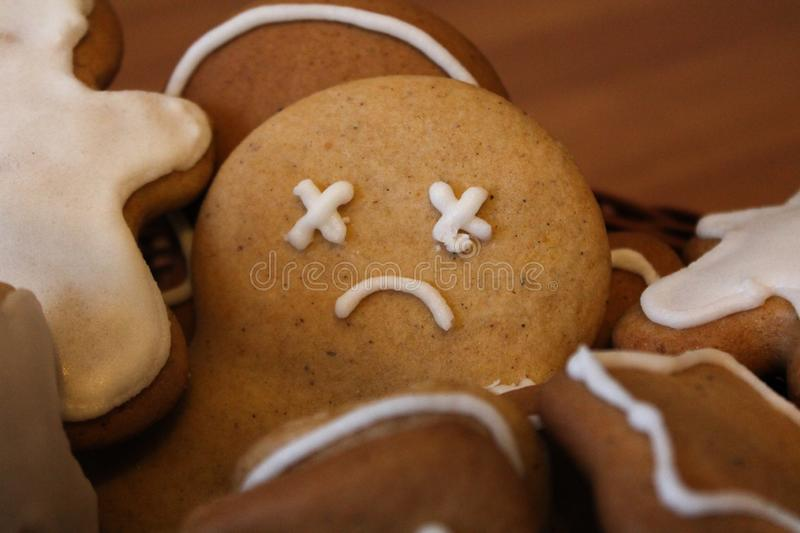 Sad gingerbread man in the woven basket stock image