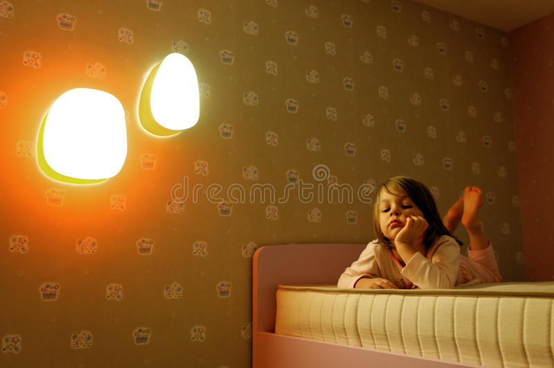 Sad girl on bed royalty free stock photography