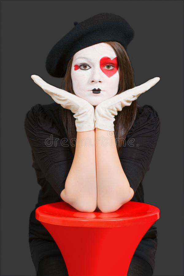 Download Sad girl with clown mask stock image. Image of clown - 14874677
